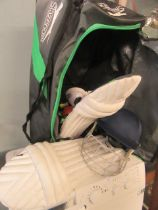 A cricket bag containing cricket equipment to include pads, helmet, gloves etc.