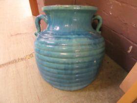 A blue glazed garden pot