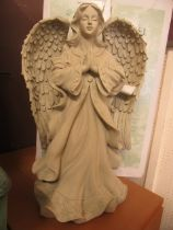 A garden angel with box