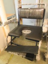 A heavy duty four wheeled commode chair