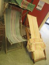 Two wooden reclining garden chairs with striped fabric