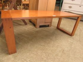 A mid-20th century elm coffee table