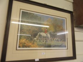 A framed and glazed hunting print signed in pencil