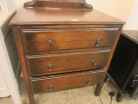 A mid-20th century oak chest of three drawers