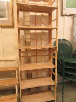 Two folding shelf units