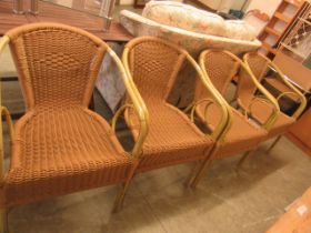 A set of four wicker open armchairs