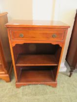 A modern yew veneered open bookcase with single drawer above