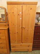A modern pine two door wardrobe (A/F)