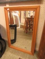 A modern pine framed bevel glass mirror