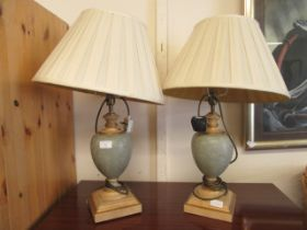 A pair of modern table lamps with urn columns