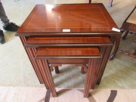 A nest of three modern mahogany tables