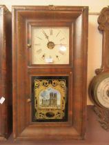 An early 20th century walnut cased American drop-dial wall clock with glass panel depicting