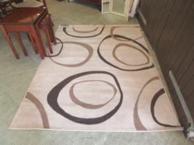 A modern beige ground rug