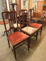 A set of three early 20th century dining chairs along with one other