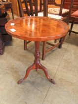 A reproduction yew pedestal wine table
