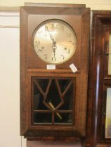 An early 20th century oak cased drop-dial wall clock