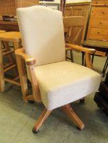 A modern pine framed swivel office chair