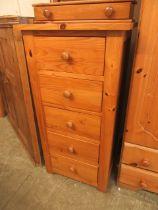 A modern pine five drawer chest