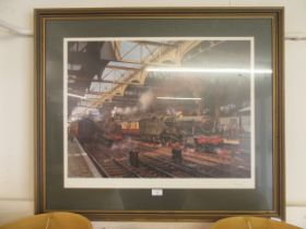 A framed and glazed Terrance Culio steam locomotive print