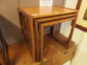 A mid-20th century G-Plan nest of three teak occasional tables