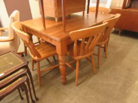A modern pine kitchen table along with a set of four beech kitchen chairs (A/F)