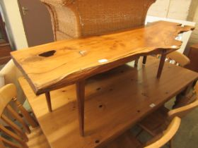A modern yew coffee table on tapering legs