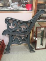 A pair of green painted cast iron bench ends CONDITION REPORT: We do not deal with