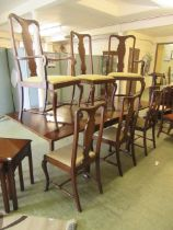 A modern mahogany extending dining table along with a set of six (four plus two) Queen Anne style