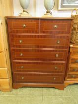 A modern mahogany veneered chest of two short over four long drawers