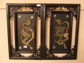 Two reproduction Chinese plaques of dragons