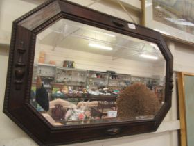 A mid-20th century oak framed bevel glass wall mirror