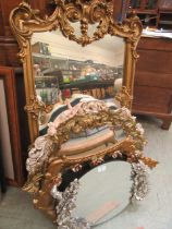 A selection of reproduction ornate framed wall mirrors