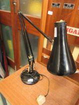 A black angle-poise style lamp