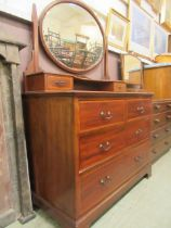 An Edwardian mahogany inlaid dressing chest having swing mirror to back the base having two small
