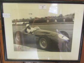A framed and glazed print of Sterling Moss signed bottom left