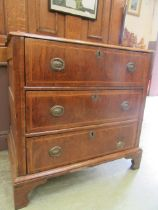 A mid-18th century small walnut and oak chest of three drawers