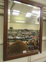 A mahogany inlaid framed bevelled glass wall mirror
