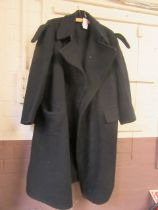A navy blue trench coat with military lapels