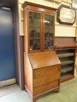 An Edwardian mahogany inlaid bureau bookcase (A/F)