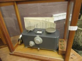 A cased set of balance scales
