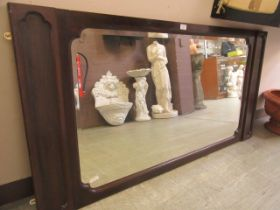 A mahogany framed over mantle mirror