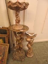 A jardiniere stand in the form of a cherub together with two other similar gold painted planters