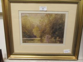 A framed and glazed watercolour of a country lake scene signed bottom left
