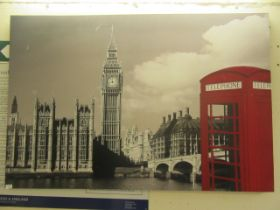 A stretched canvas of London with red phone box