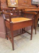 An Edwardian mahogany box stool