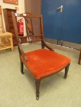An Edwardian mahogany and inlaid bedroom chair