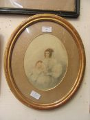 An oval framed and glazed watercolour of mother and children