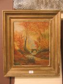 A framed oil on board of river through wood scene