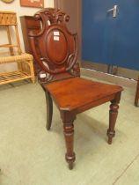 A Victorian mahogany shield back hall chair