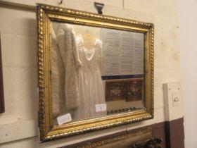 A gilt framed mirror
